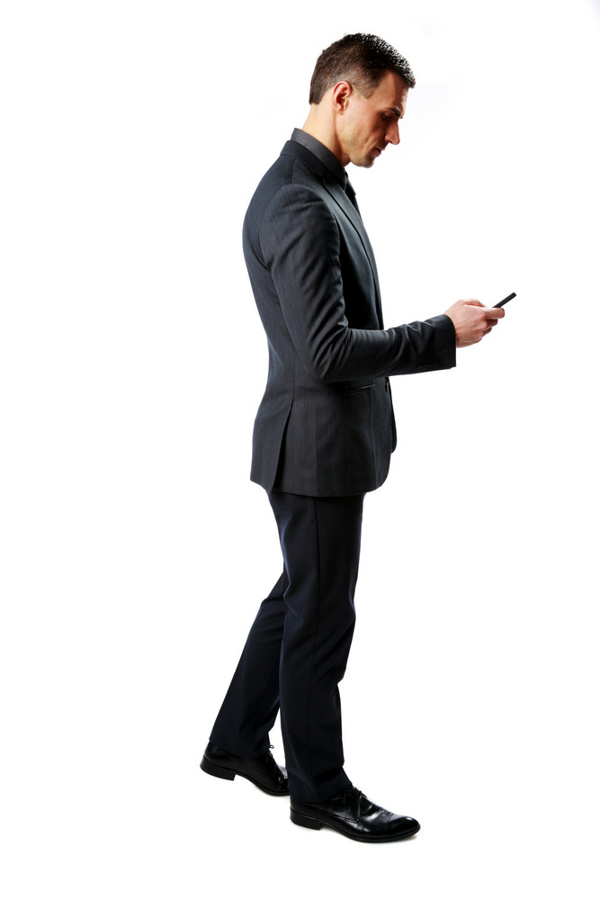 Side view portrait of a businessman using smartphone isolated on a white background
