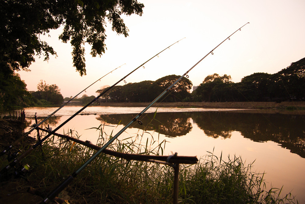 silhouette hook on river