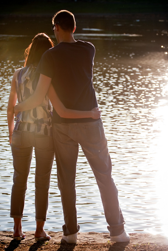 Silhouette of an affectionate couple embracing each other in the early evening hours.