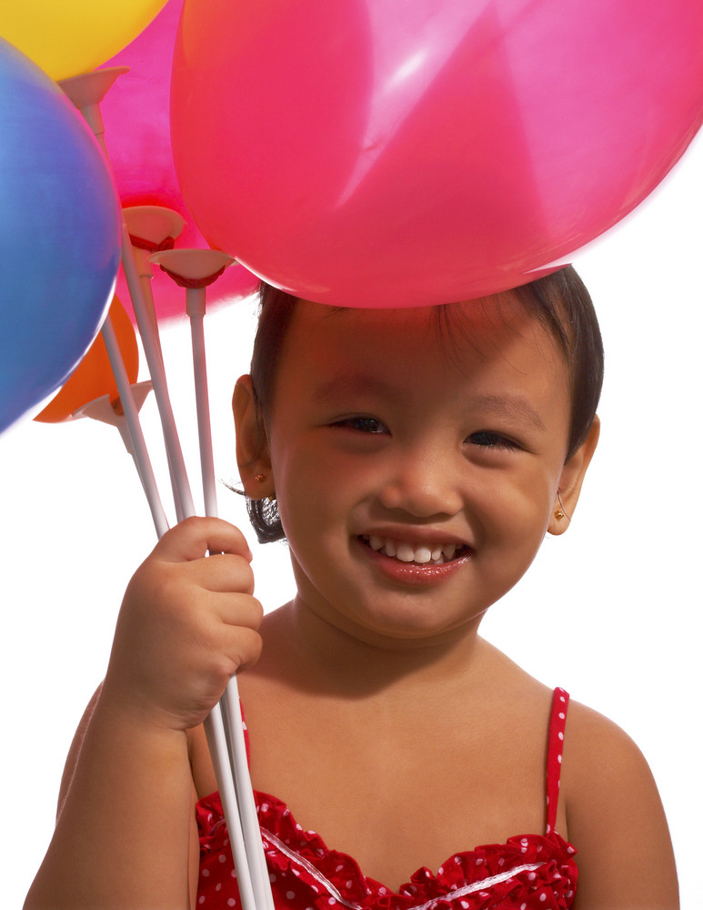Small Kid Holding Balloons