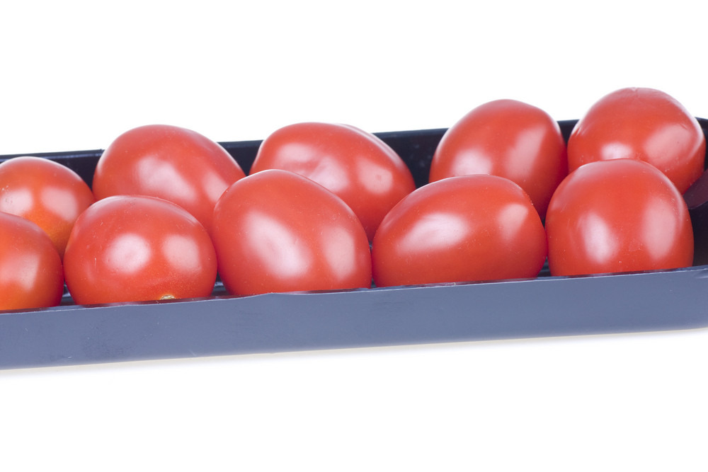 Small Red Tomatoes In The Box