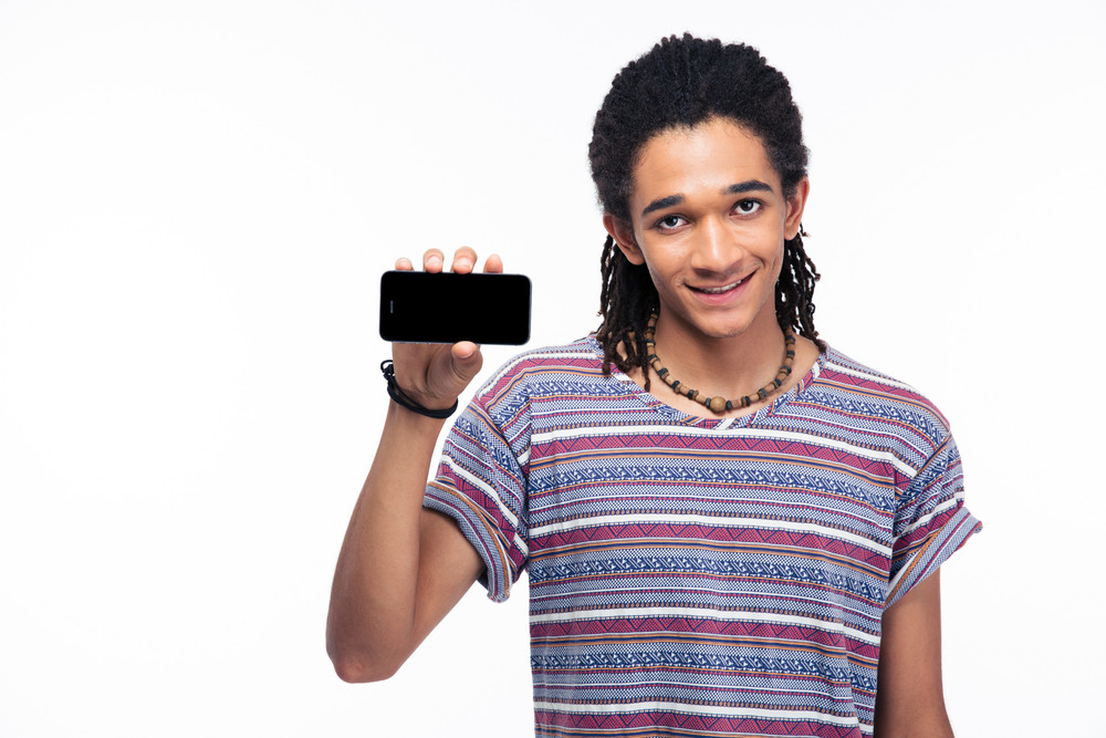 Smiling african man showing blank smartphone screen