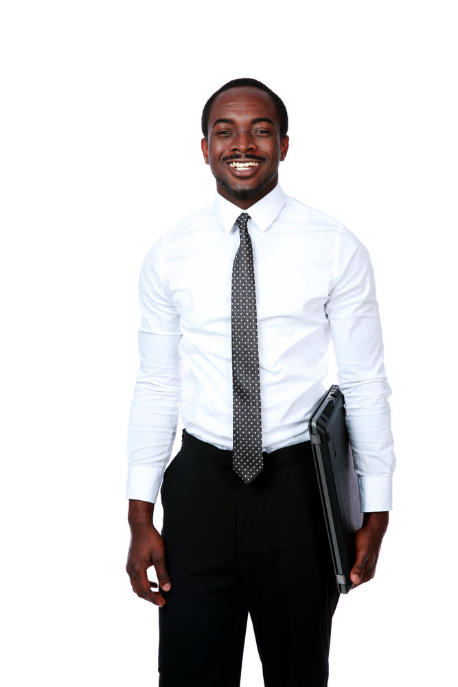 Smiling african man standing with laptop isolated on white background