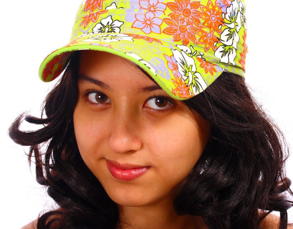 Smiling And Attractive Teenage Girl Wearing A Cap