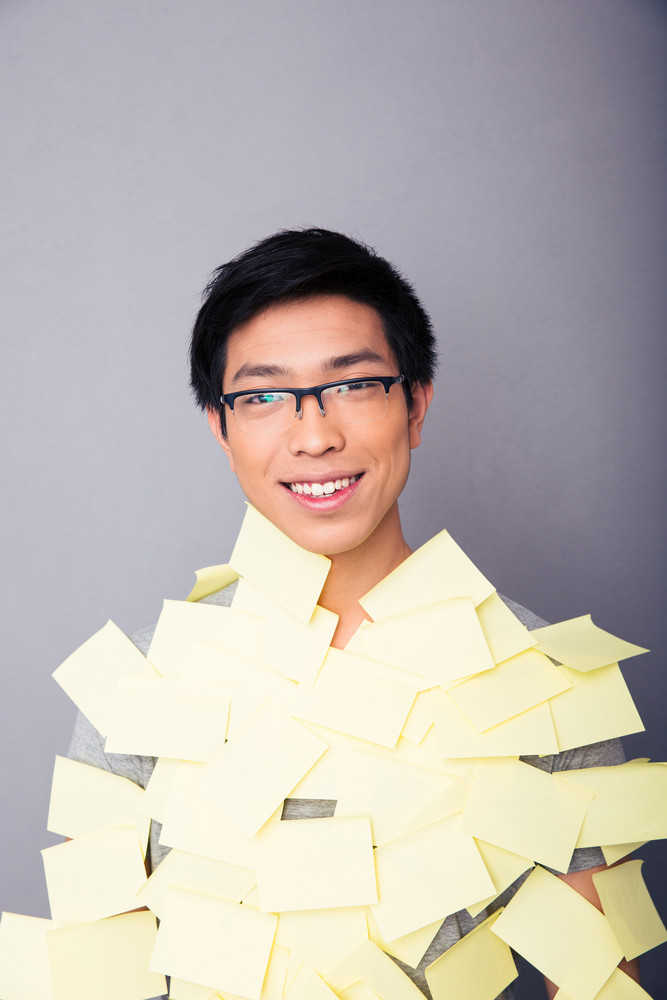 Smiling asian man pasted stickers