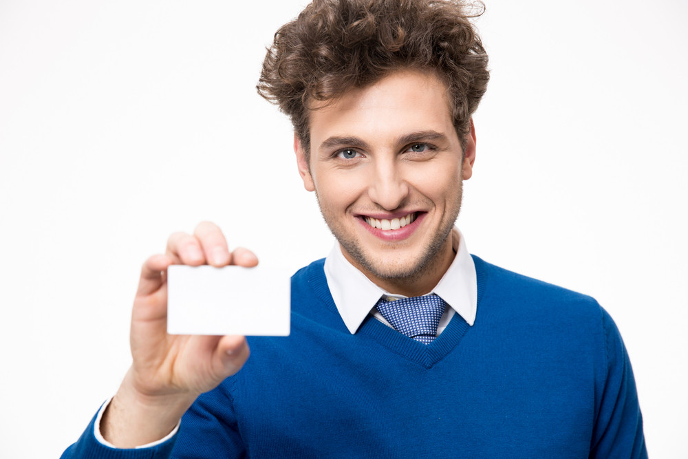 Smiling businessman showing blank business card