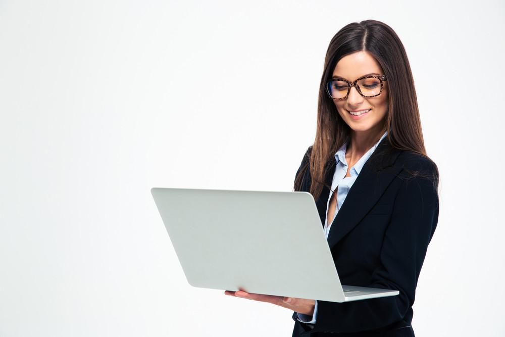 Smiling businesswoman using laptop