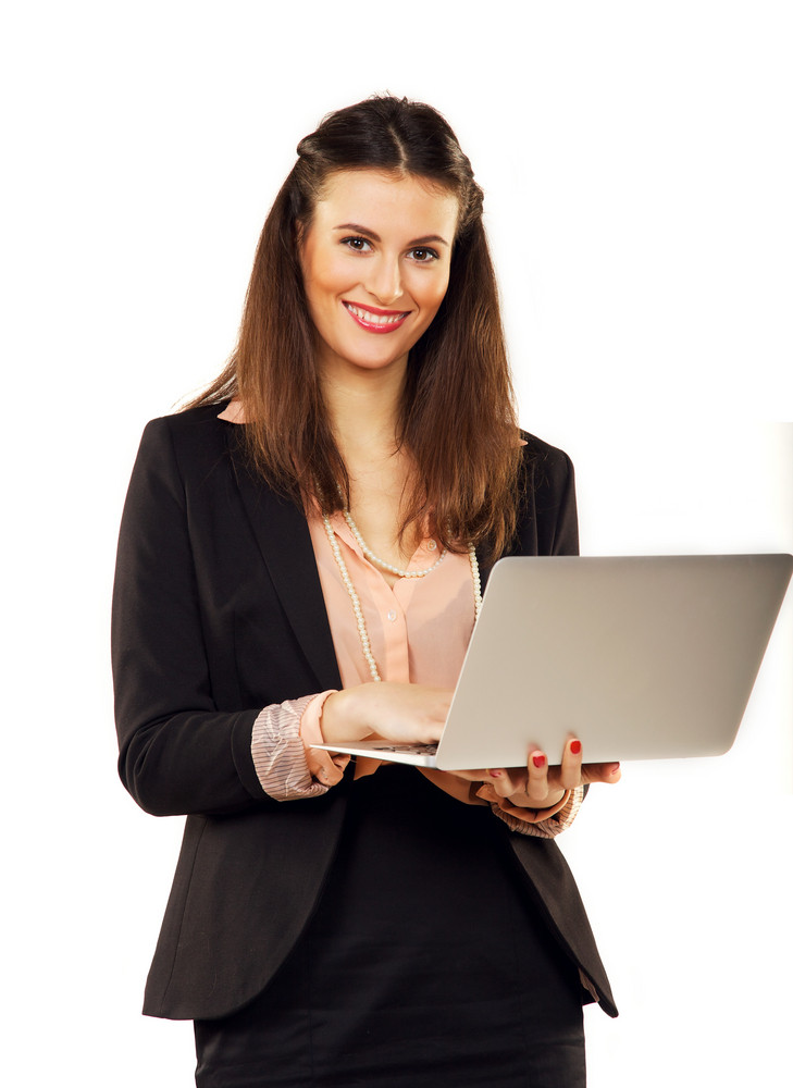 Smiling confident businesswoman in a studio browsing the internet