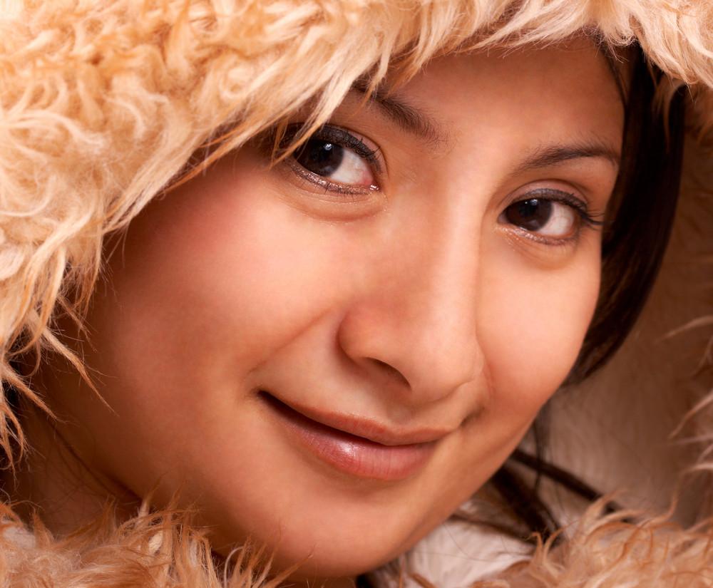 Smiling Girl In A Fur Coat