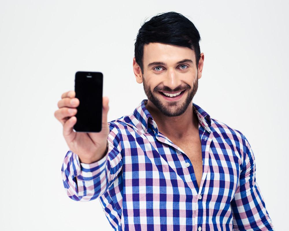 Smiling man showing blank smartphone screen