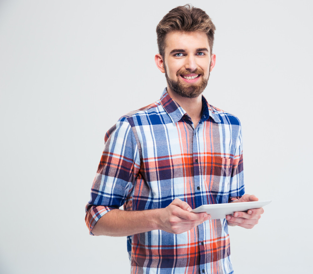Smiling man using tablet computer
