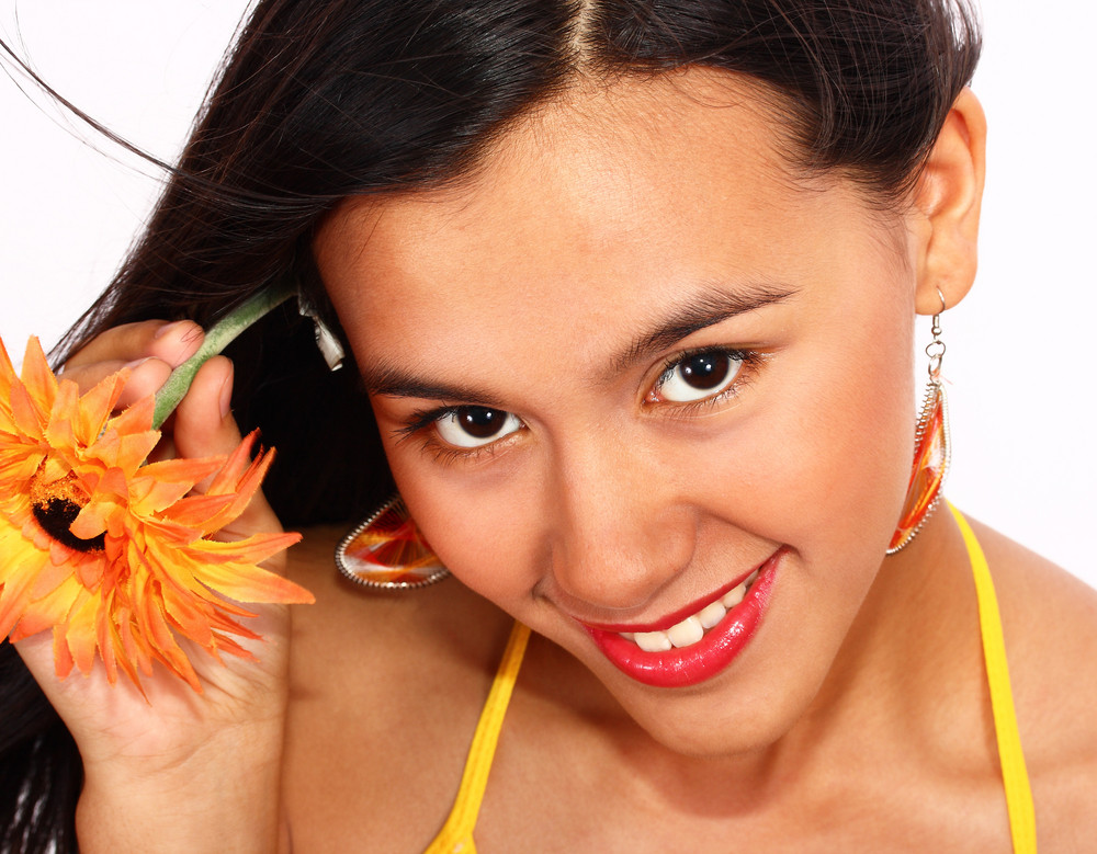 Smiling Young Lady Showing Summer Flower In Her Hair