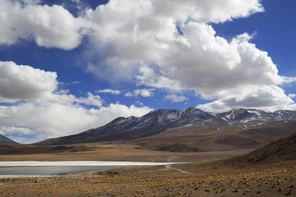 Snow-capped mountains and a tranquil lake