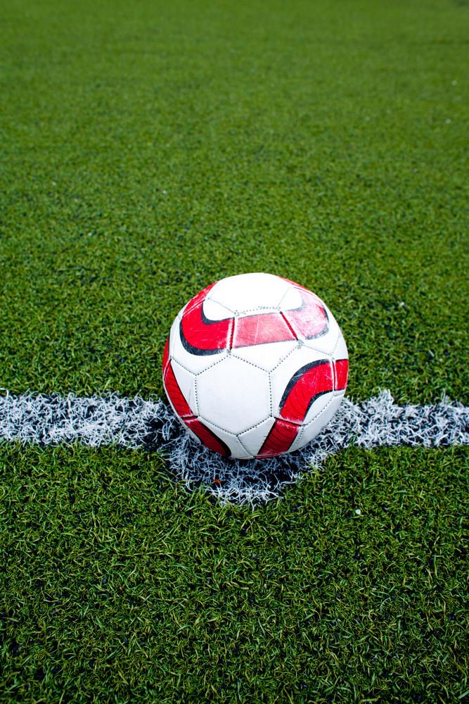 Soccer ball on the field green grass