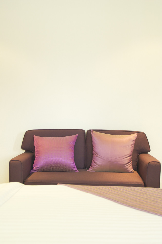 Sofa with pillow in bedroom