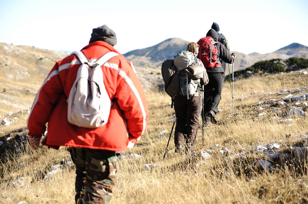 Sport hiking in mountains, walking and backpacking