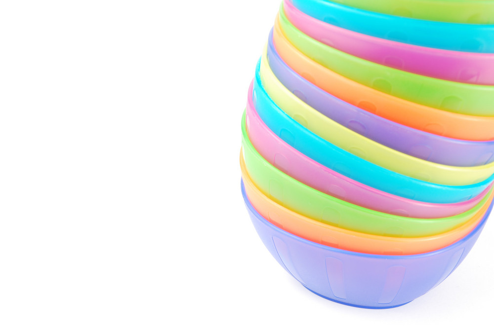 Stacked Colorful Bowls On White