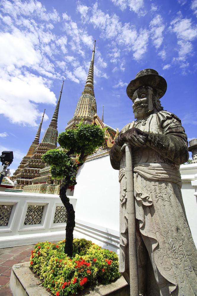 Statue of Man at Wat Pho in Bangkok Thailand