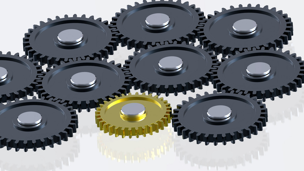 Steel Gears In Connection With Gold One. Concept For Teamwork And Business.