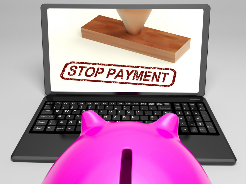 Stop Payment Stamp On Laptop Showing Rejected