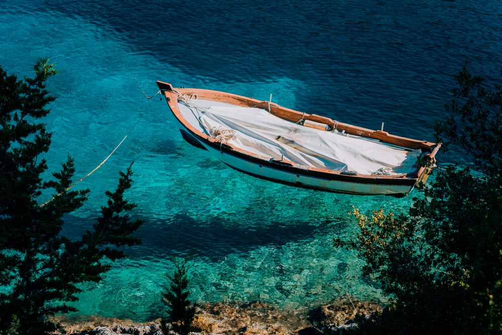 Blue waters of Foki Fiskardo Beach. Fiskardo, Kefalonia, Greece