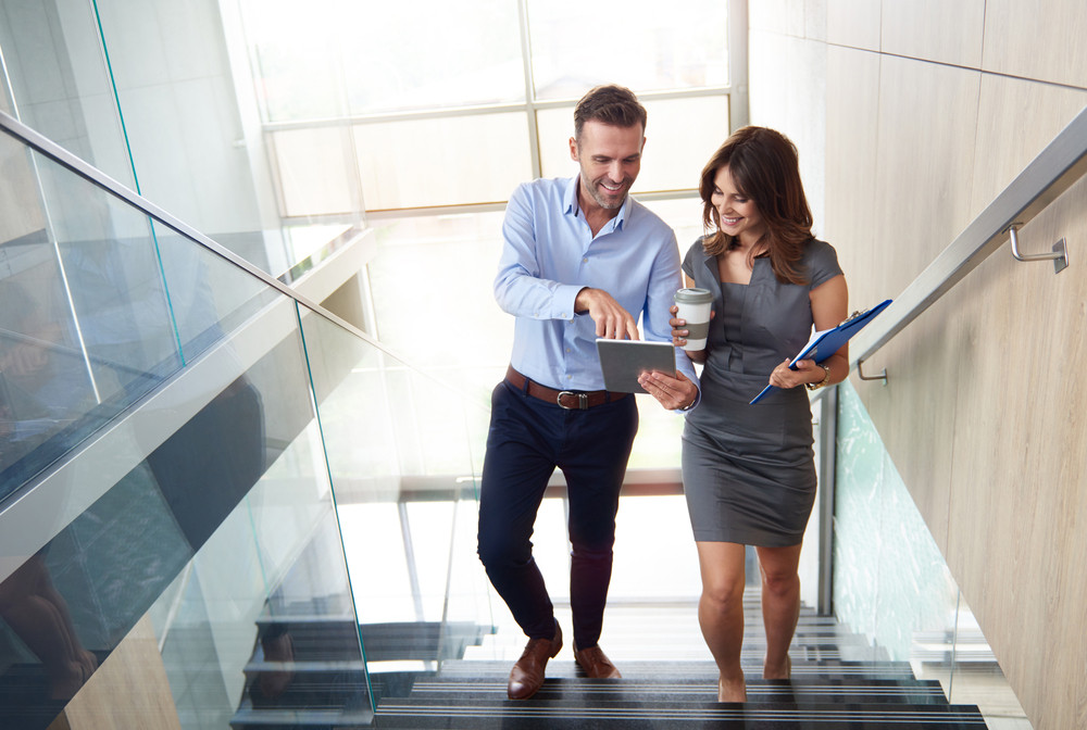 Business partners walking up stairs