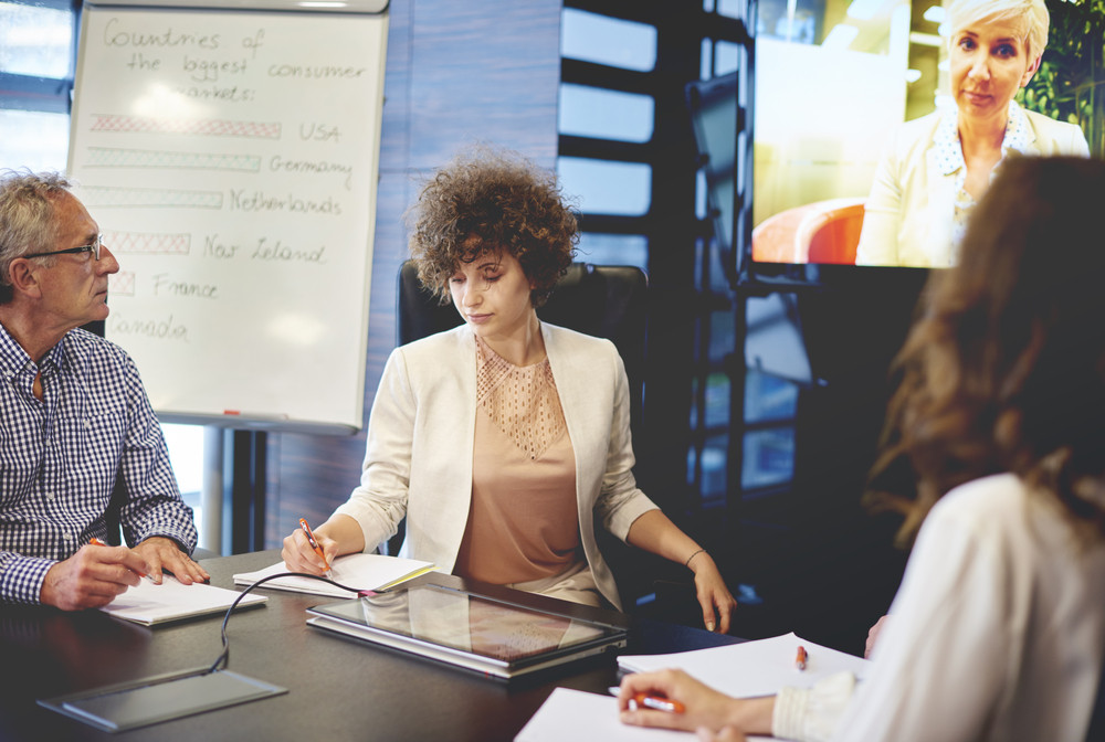 Business people video conferencing in board room Royalty-Free Stock