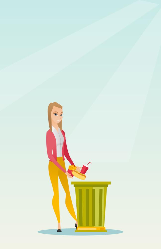 Caucasian woman putting junk food into a trash bin. Woman refusing to eat junk food. Woman rejecting junk food. Woman throwing junk food. Diet concept. Vector flat design illustration. Vertical layout