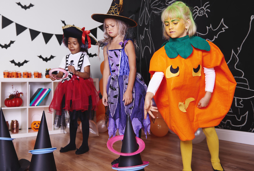 Children actively spending time at Halloween party