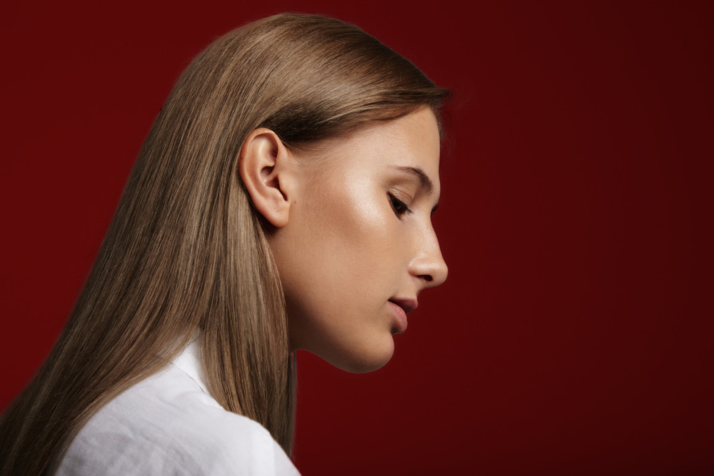closeup woman's portrait with ideal shiny skin and straight healthy hair