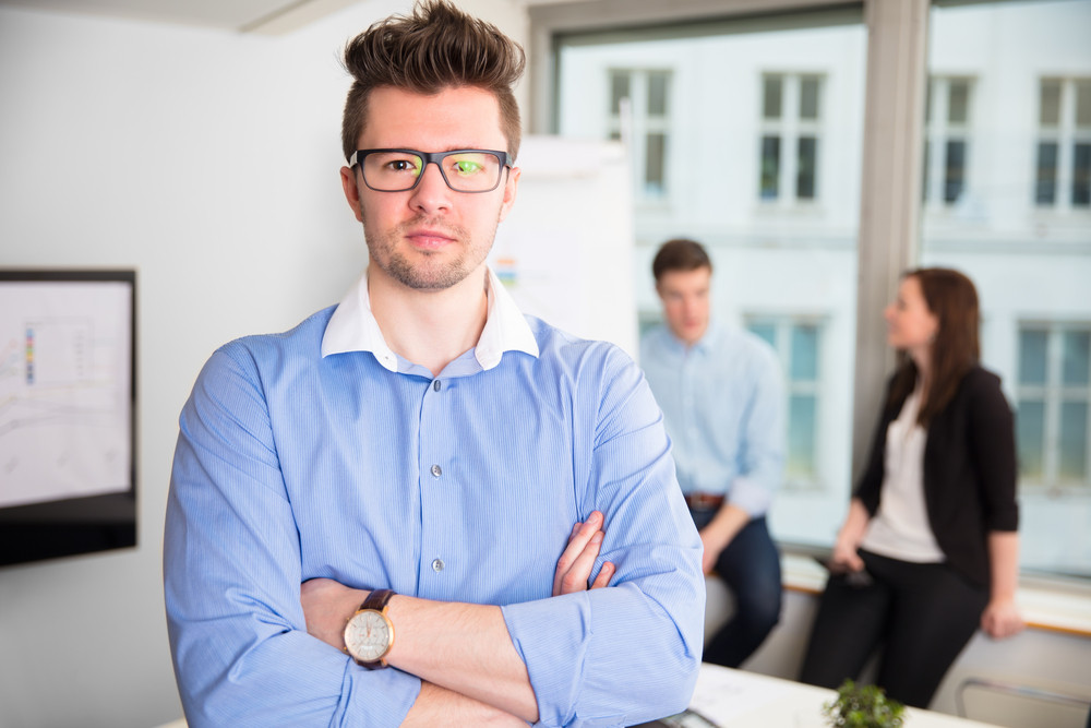 Confident Businessman With Arms Crossed Wearing Eyeglasses