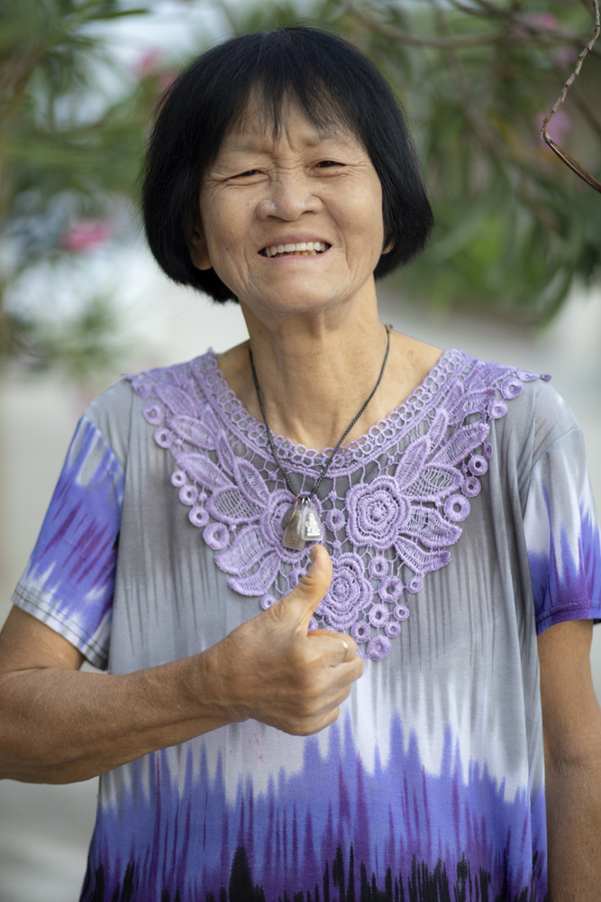 face of asian senior woman laughing with happiness emotion