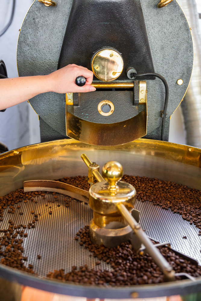 Female Handles Roaster in Organic Coffee production