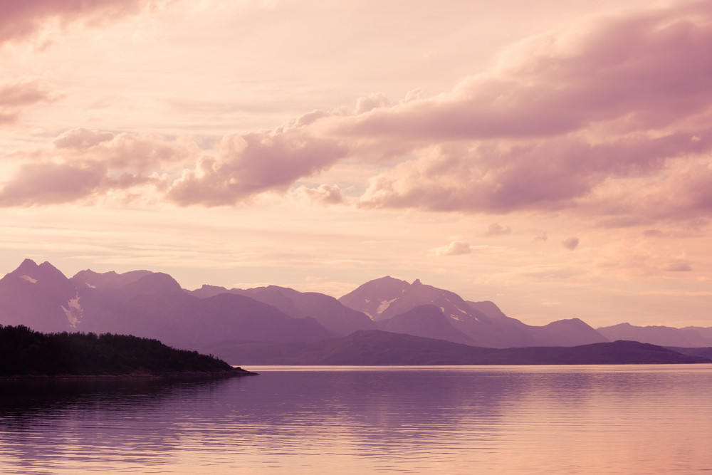 Fjord in early morning, rocky seashore at sunrise, Norway