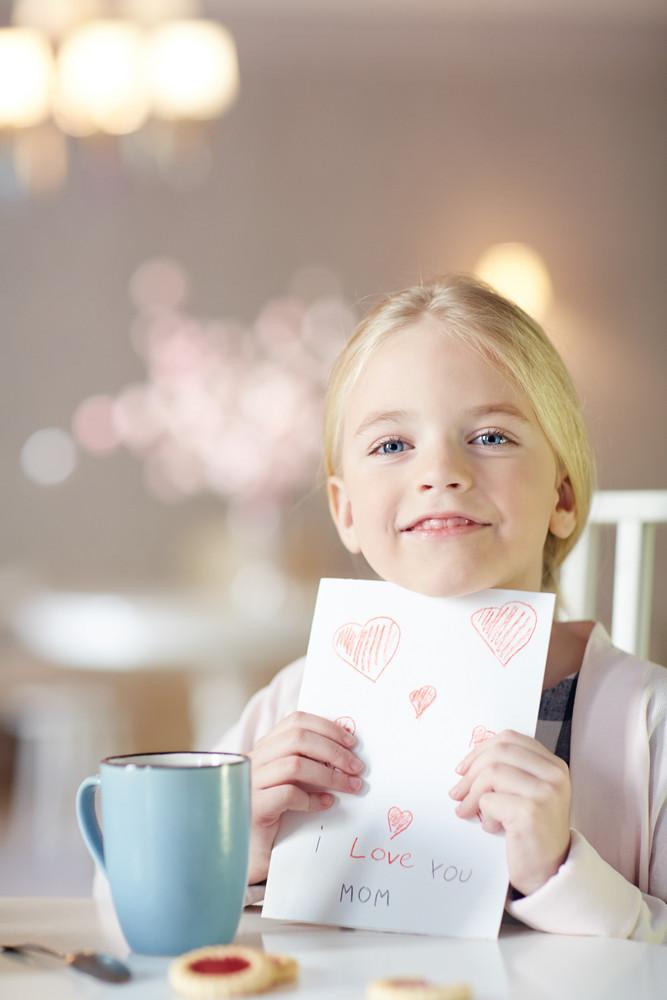 Girl with handmade greeting card