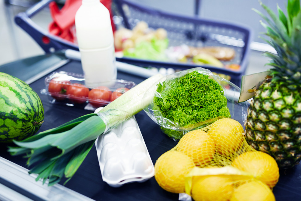 Group of healthy food products on supermarket checkout