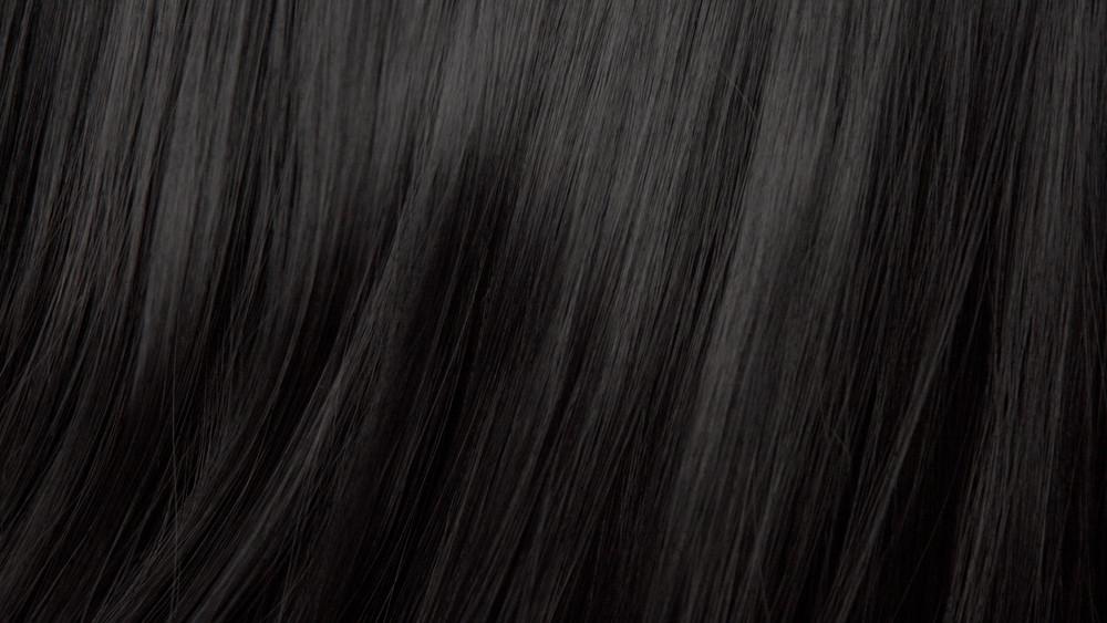 Hair texture background, no person. Black shiny hair comb texturte