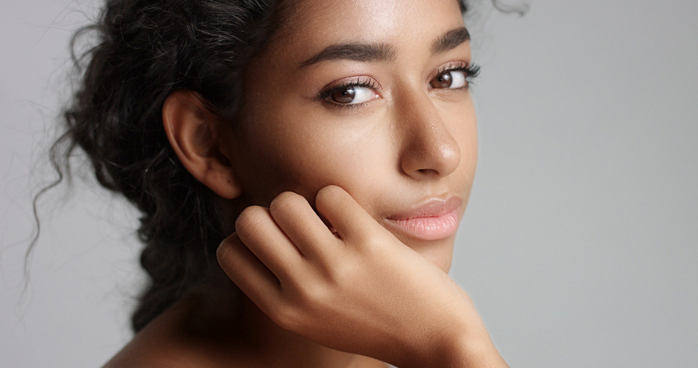 Happy Serene Young Woman With Beautiful Olive Skin And Curly Hair