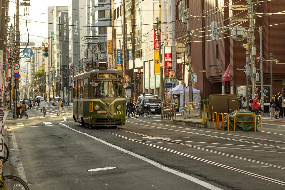 hokkaido japan - octobor 8,2018 :  old model of supporo city street car ,tram running on track ,sappora is principle city in hokkaido island northern of japan