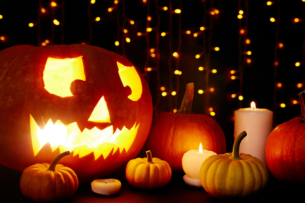 Holiday lights, candless and pumpkins in the dark