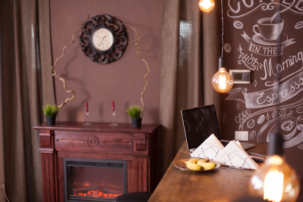 Interior design of a vintage coffee shop with fireplace in the background. Artistic drawing.