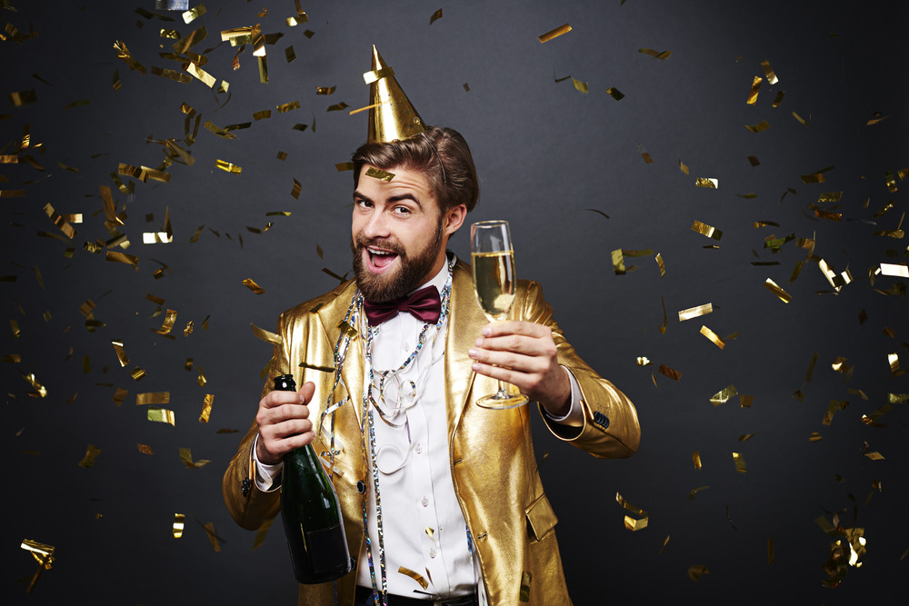 Joyful man drinking a champagne