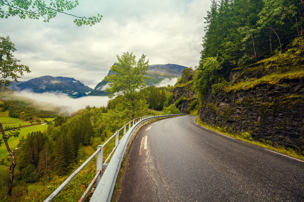Landscape with mountain road. The view through the windshield