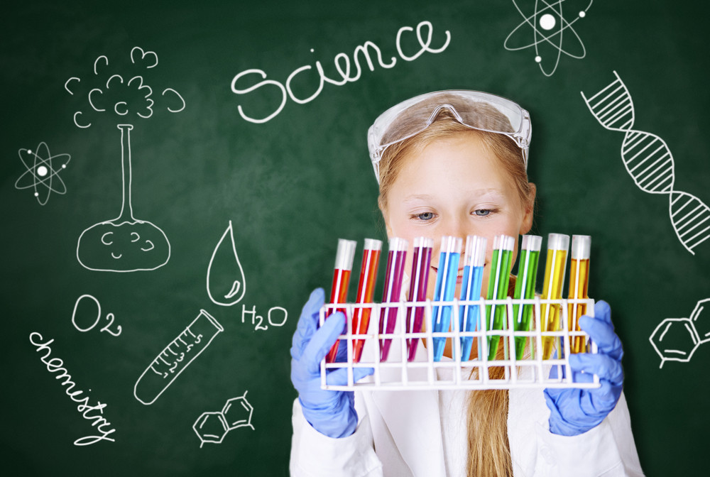 Little girl working in chemical laboratory