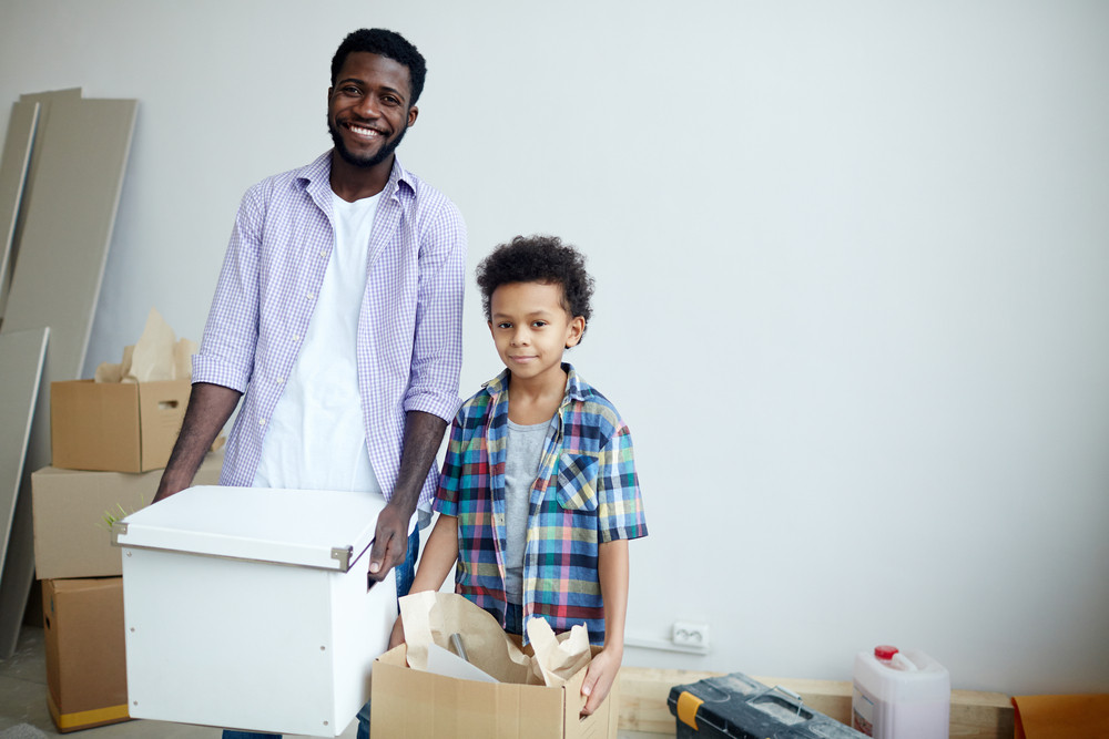 Man and little boy leaving old house