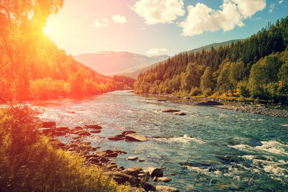 Mountain river at sunset. Norway