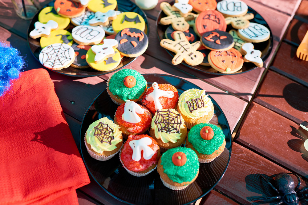 Plates with Halloween cupcakes and cookies