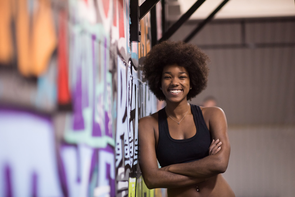 c64df79b5 portrait of a young beautiful African American women in sports clothes  after a workout at the