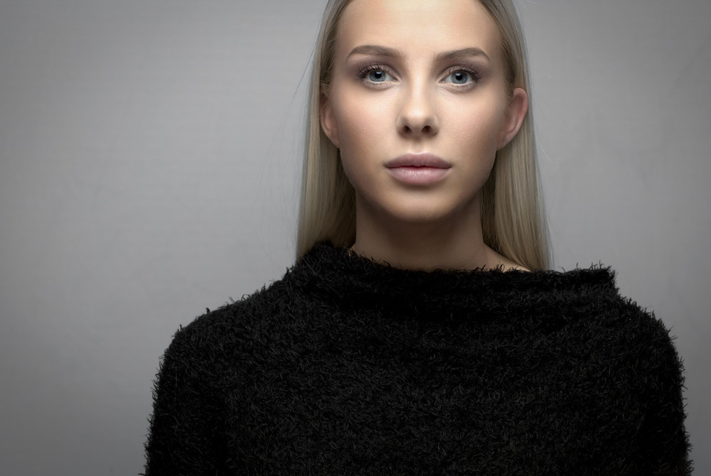 Portrait of a young blonde woman with fury jacket