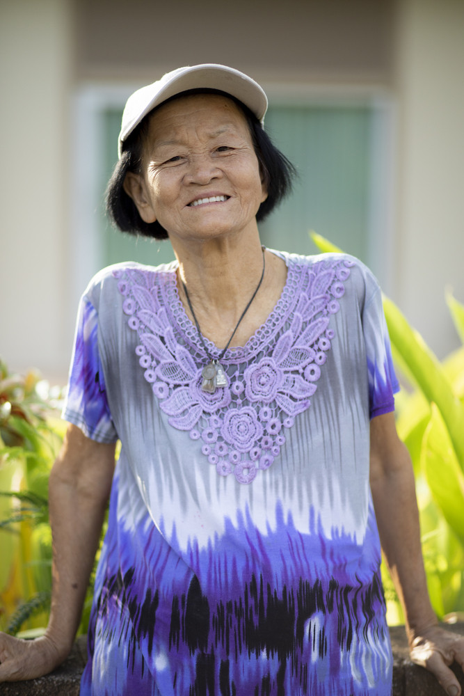 portrait of old woman toothy smiling face happiness emotion standing in public park